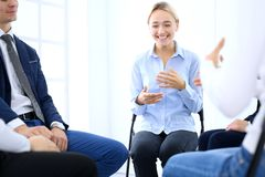 Group of people sitting in a circle during therapy. Meeting of business team participating in training.  royalty free stock photo