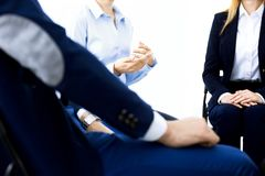 Group of people sitting in a circle during therapy. Meeting of business team participating in training.  stock images
