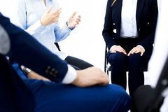 Group of people sitting in a circle during therapy. Meeting of business team participating in training.  stock photography
