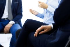 Group of people sitting in a circle during therapy. Meeting of business team participating in training.  royalty free stock images