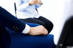 Group of people sitting in a circle during therapy. Meeting of business team participating in training.  royalty free stock photos
