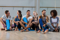 Group of people sitting on floor Stock Image