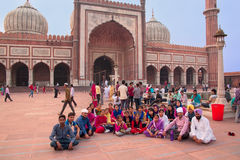 Group of people sitting at Jama Masjid in Delhi, India Stock Photography