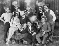 Group of people sitting in a living room smoking Stock Photo
