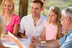 Group of people sitting and playing cards Royalty Free Stock Photo