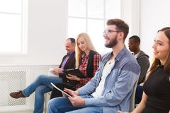 Group of people sitting at seminar, copy space royalty free stock image