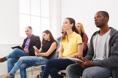 Group of people sitting at seminar, copy space royalty free stock photo