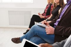 Group of people sitting at seminar, copy space. Unrecognizable audience listening to speaker. Education, conference, workshop concept stock photos