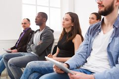 Group of people sitting at seminar, copy space stock photo