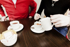 Coffee with friends. Friends at a table having coffee Royalty Free Stock Photography