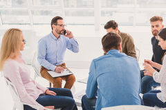 Group of people sitting together stock photo