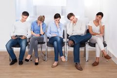 Group of people sleeping on chair Royalty Free Stock Photos