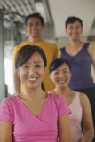 Group of people smiling and exercising in the gym, portrait Royalty Free Stock Photos