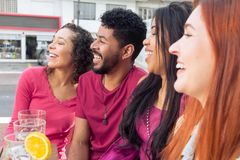 Group of people socializing in a party at restaurant outside stock photos