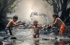 Group of People Splashing Water Royalty Free Stock Photo