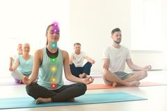Group of people in sportswear practicing yoga stock image
