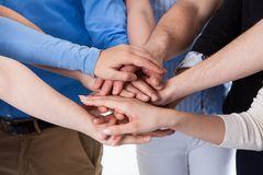 Group of people stacking hands together Stock Images