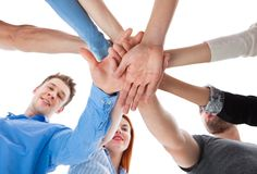 Group of people stacking hands together Royalty Free Stock Photos