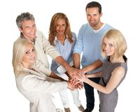 Group of people stacking their hands together Royalty Free Stock Photos