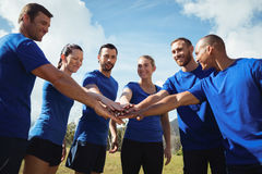 Group of people stacking their hands together royalty free stock images