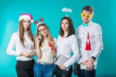 A group of people staff of 4 people. Sad new year party in the office. Caucasian people are young displeased, sad royalty free stock image
