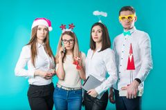 A group of people staff of 4 people. Sad new year party in the office. Caucasian people are young displeased, sad stock photography