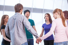 Group of people standing in circle. Stock Photos