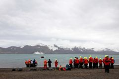 Group of people standing at Deception Island, Antarctica Royalty Free Stock Photo
