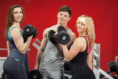 Group of people standing with freeweights in fitness center Royalty Free Stock Photos