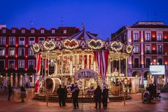 Group of People Standing at the Front of Carousel Royalty Free Stock Photo