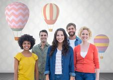 Group of people standing in front of hot air balloons. Digital composite of Group of people standing in front of hot air balloons Stock Images