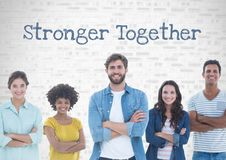 Group of people standing in front of stronger together text Royalty Free Stock Photo