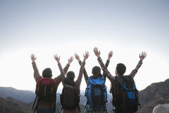 Group of people standing with hands outstretched Stock Images