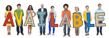 Group of People Standing Holding Available Letter Stock Photo