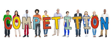 Group of People Standing Holding Competition Letter.  Stock Photo