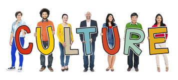 Group of People Standing Holding Culture.  Royalty Free Stock Image