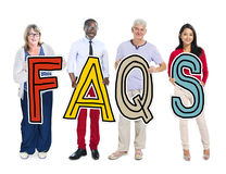 Group of People Standing Holding FAQS Letter Concept Royalty Free Stock Photography