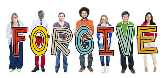 Group of People Standing Holding Forgive Letter.  Royalty Free Stock Photo