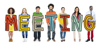 Group of People Standing Holding Meeting Letter Stock Image