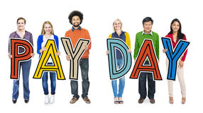 Group of People Standing Holding Payday Letters Royalty Free Stock Photos