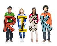 Group of People Standing Holding Risk Letter Royalty Free Stock Photos