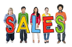 Group of People Standing Holding Sales Letters Royalty Free Stock Image