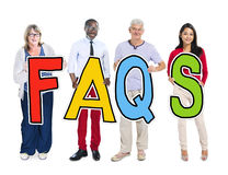 Group of People Standing Holding Word FAQS Royalty Free Stock Photo