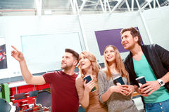 Group of people standing and pointing upwards Stock Image