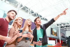 Group of people standing and pointing upwards Stock Photo