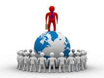 Group of people standing round globe. Stock Images