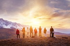 Group people sunset mountains view stock photo