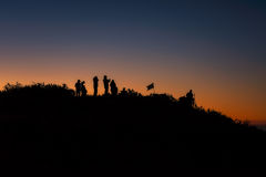 A group of people stands on a mountains at the sunrise. Silhouette A group of people stands on a mountains at the sunrise  On the top Doi Luang Chiang Dao Stock Image