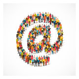 Group of people stands in the at symbol Royalty Free Stock Image
