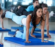 Group of people stretching Stock Images